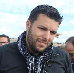 Candid photo of Hassan Karajah
