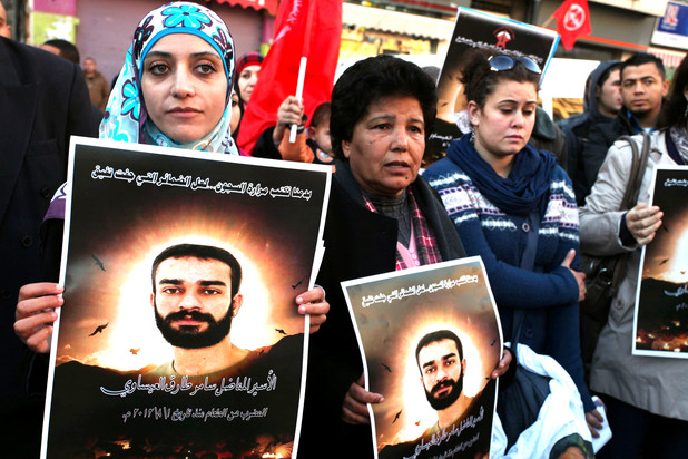 Shireen Issawi (left) at a Ramallah protest in support of her brother Samer