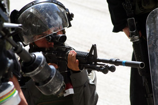 Close-up of Israeli soldier aiming weapon