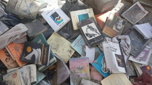 Burned books from the collection of Palestinian poet Othman Hussein