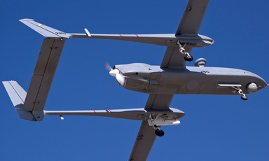 An Unmanned Aerial Vehicle is seen against a blue sky