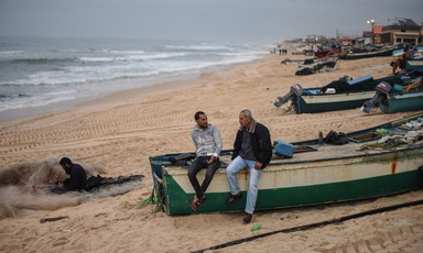 Two men sit on boat