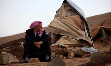 Man looks at the pile of rubble around him