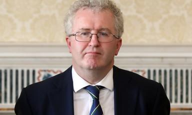 Man wearing spectacles and tie.