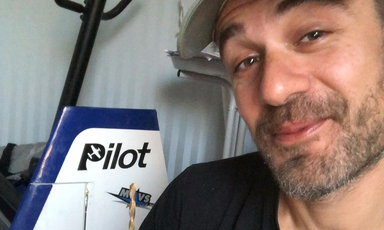 Man poses with model airplane