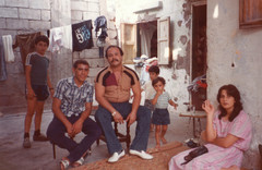 Photograph from the 1980s shows family sitting in refugee camp