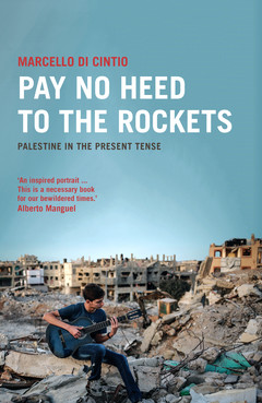Cover of Pay No Heed to the Rockets book shows boy playing guitar while sitting on rubble of bombed-out building