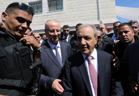 Bodyguards surround Rami Hamdallah and Majid Faraj