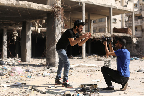 Omar Elemawi films Palestinian rapper Ibrahim Ghunaim (MC Gaza) in front of destroyed buildings in Gaza City