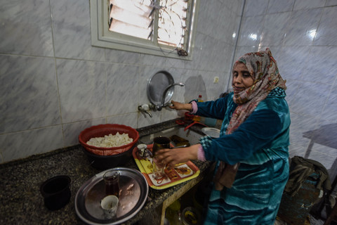 A woman near her kitchen sink