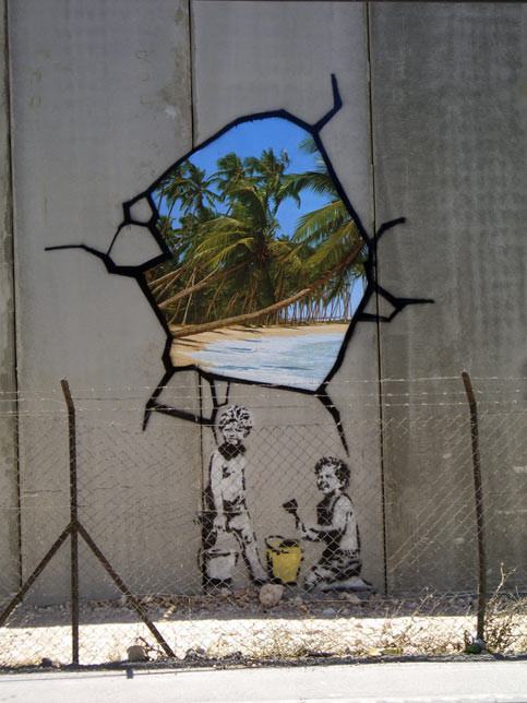 well known uk graffiti artist banksy hacks the wall the electronic intifada. Black Bedroom Furniture Sets. Home Design Ideas