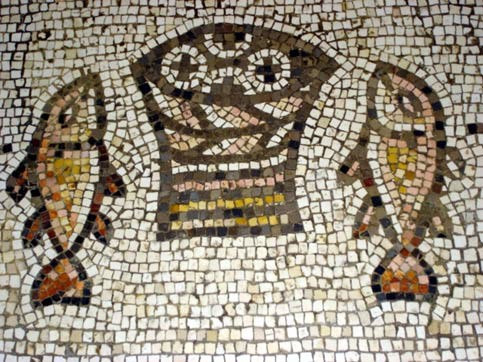 Image: A famous ancient mosaic in the Church of the Loaves and Fishes on the sea of Galilee (taken by Christi Hoover Seidel)