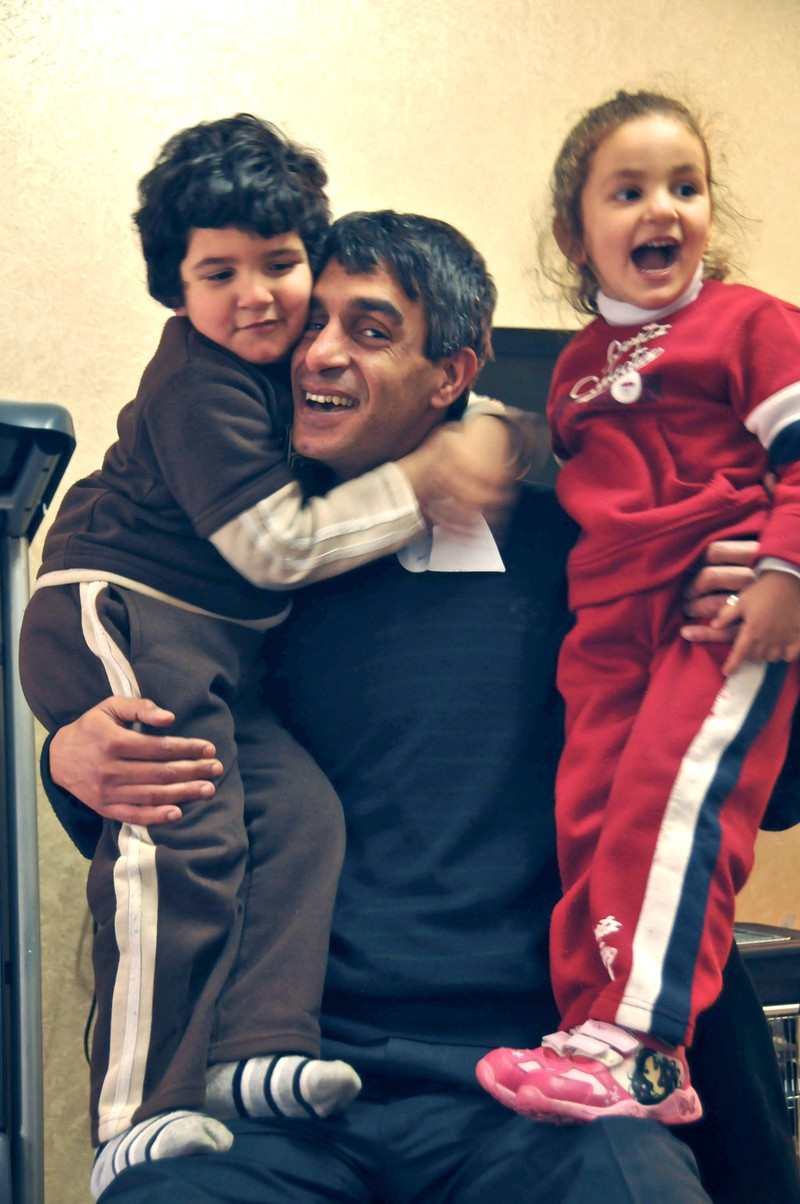 Taiseer Khatib embraces his small children