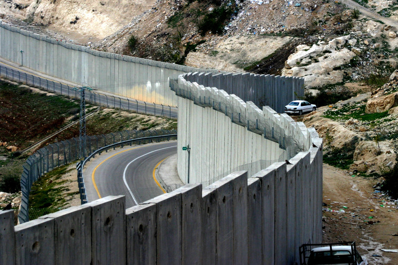 Aerial view of Israel's wall in the West Bank with a settler road along one side
