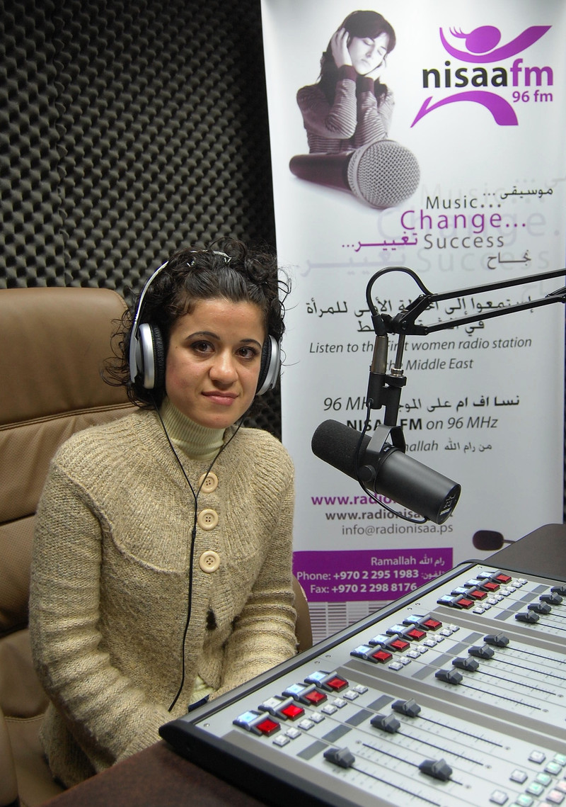 Nisreen Awwad sits in recording studio