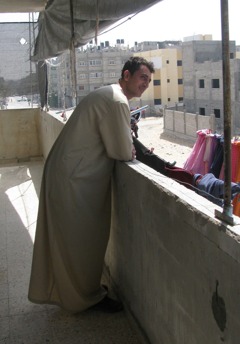 Raed Abu al-Zomar on his balcony overlooking a housing project