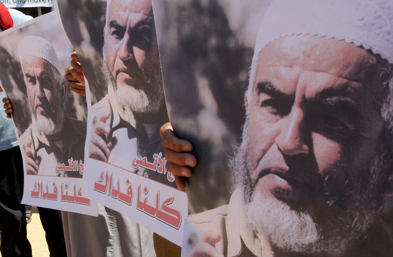 Close-up on posters of Raed Salah's face