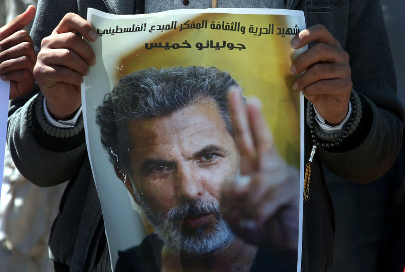 Man displays poster of Juliano Mer Khamis