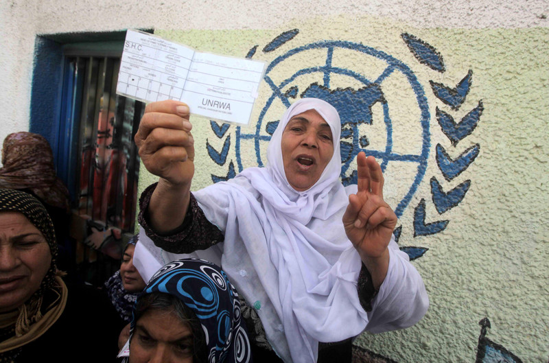 Woman displays ration card