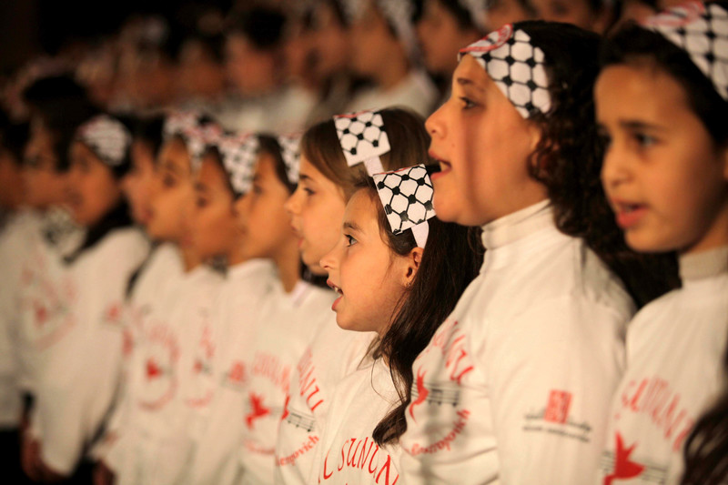 Close-up of girls singing