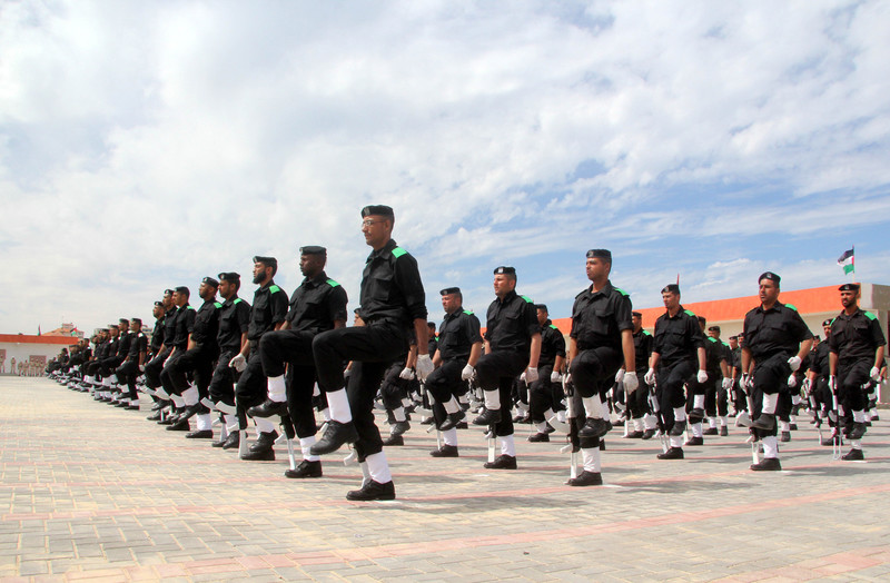 Uniformed men march in formation