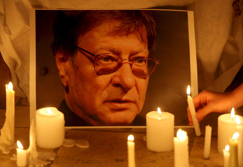 Portrait of Mahmoud Darwish illuminated by candles