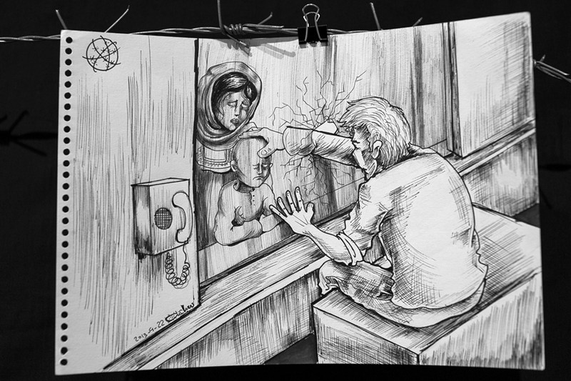 Cartoon shows imprisoned man breaking through glass partition to touch child held by woman