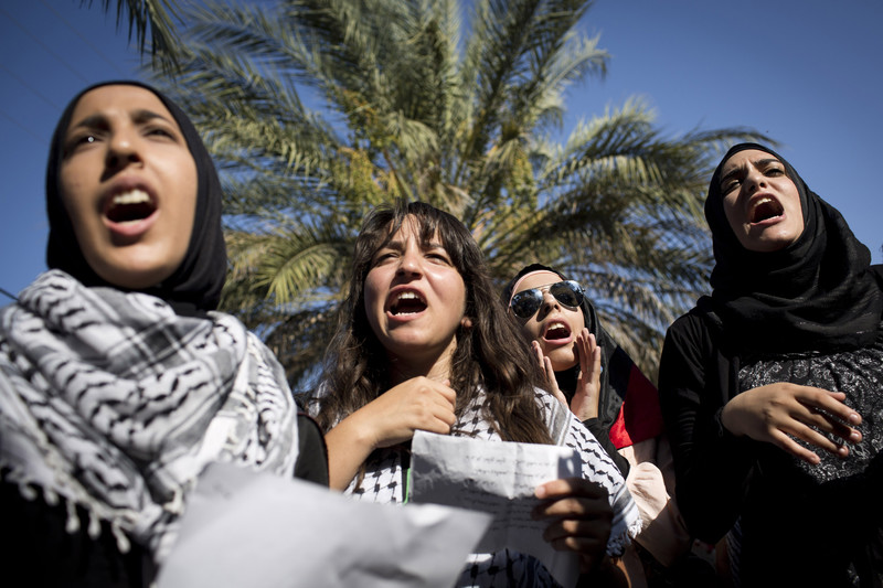 Palestinian women shout during a demonstration