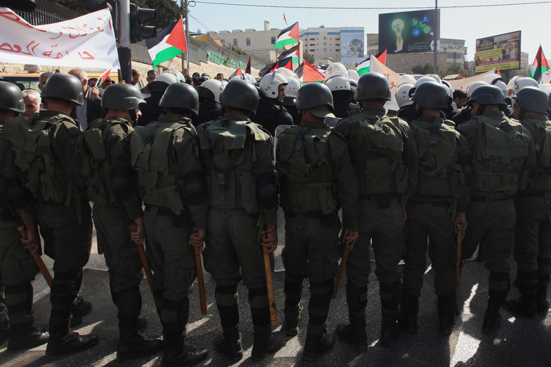 View of the backs of riot police at a demonstration