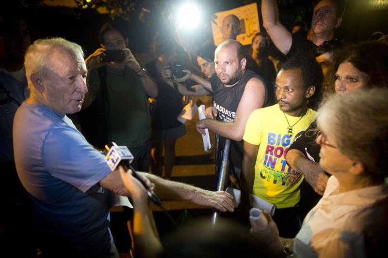 Man speaks to media at night