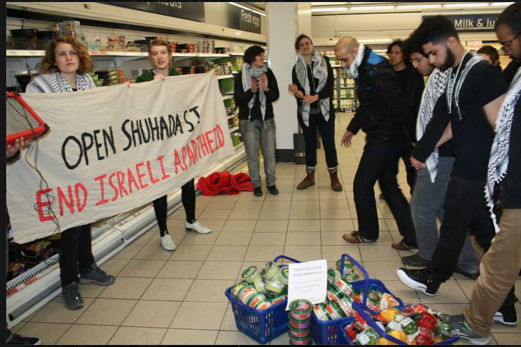 Campaigners take part in a dabke flashmob inside a Sainsbury's supermarket in London to protest it's sale of products supplied by Israeli companies that take part in the colonization of Palestinian land