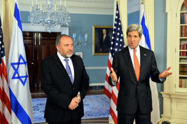 John Kerry gestures with hands while standing next to Avigdor Lieberman
