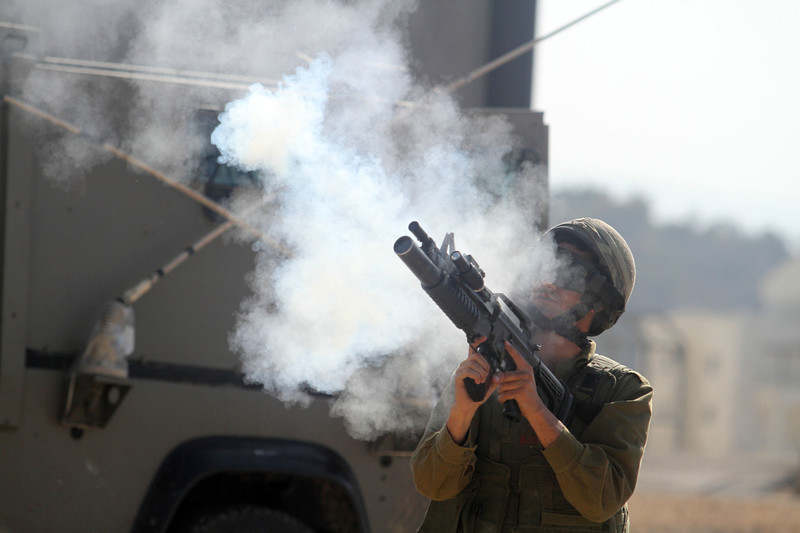 Israeli soldier fires tear gas rifle