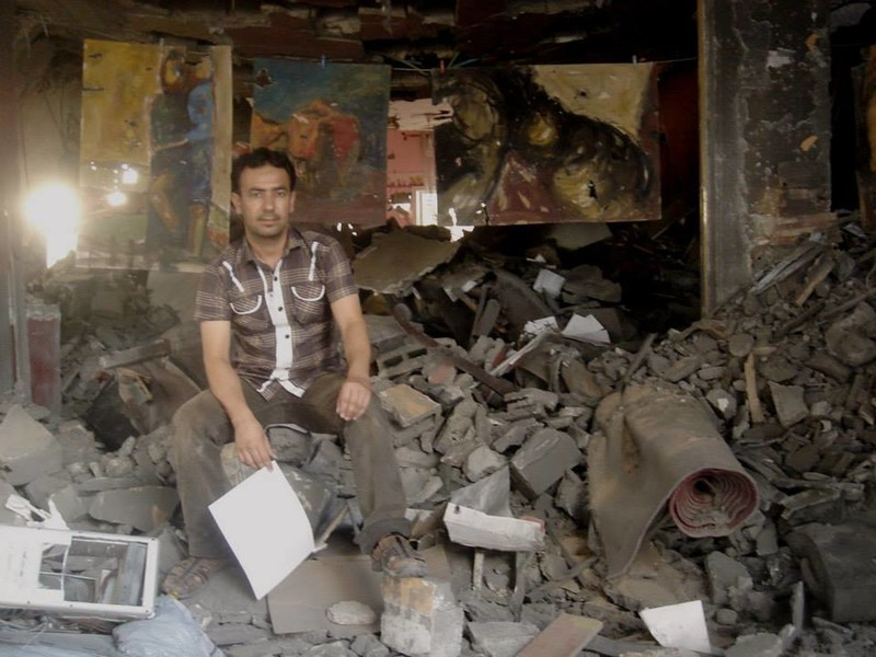 Raed Issa has hung damaged paintings in the ruins of his Gaza home.