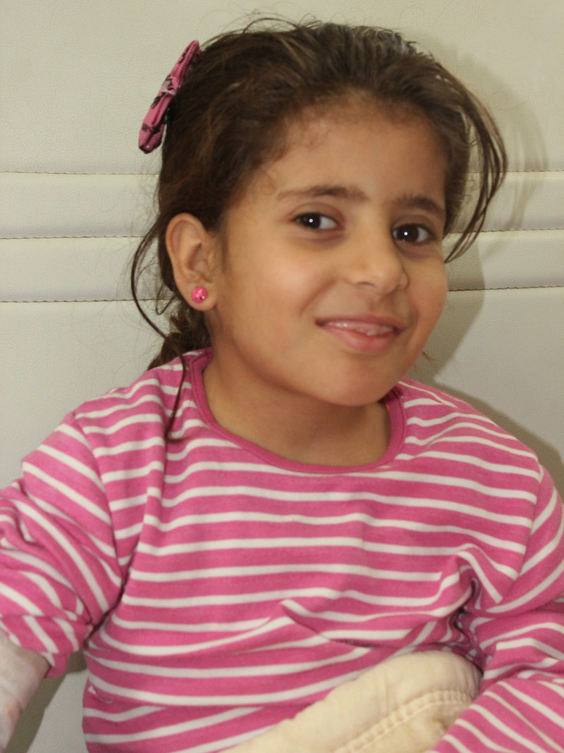 Close-up of smiling young girl