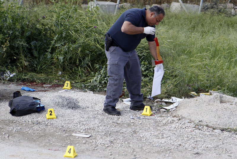 A man puts ax in plastic evidence bag