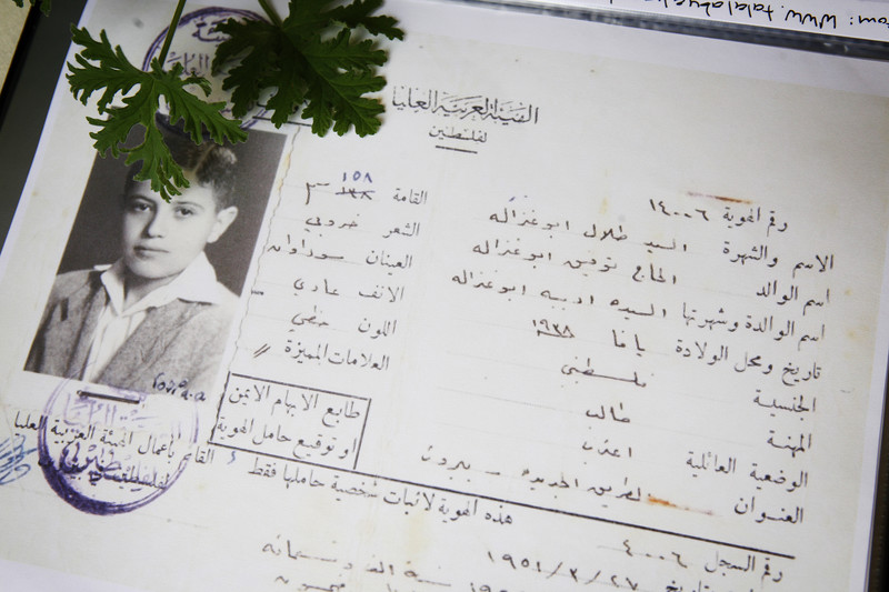 Official document showing photo of adolescent boy and his identification details in Arabic
