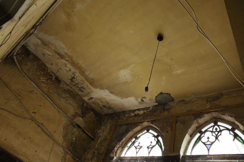 Interior view of historic building with water-damaged ceiling