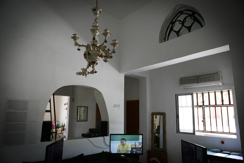 Interior of room with high ceilings, antique candelabra and white walls