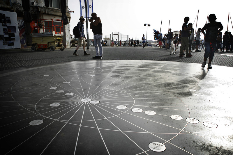 View of installation on ground with people standing around it