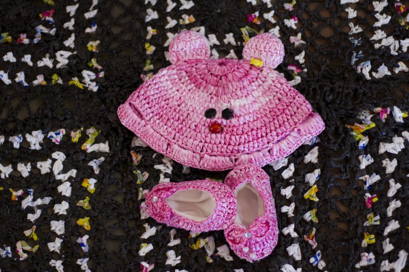 Baby's hat and booties crocheted out of plastic bags