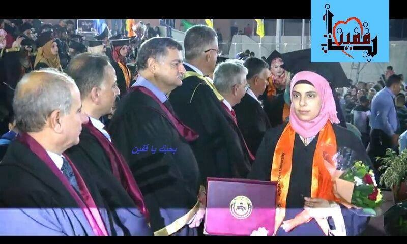 Young woman holding diploma walks past older men during graduation ceremony