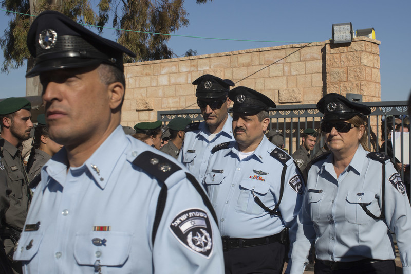 Four uniformed Israeli police officers