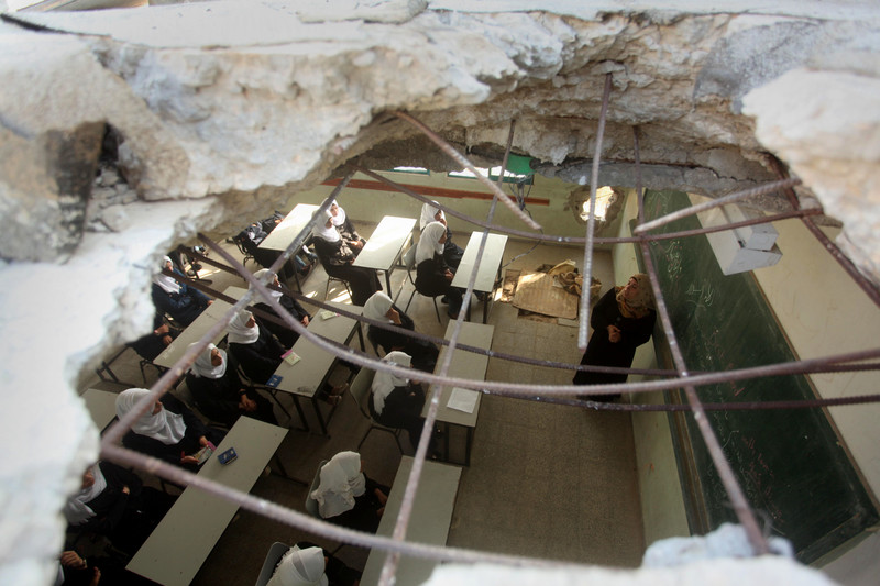 Aerial view of a classroom with a hole in the roof and in one of the walls