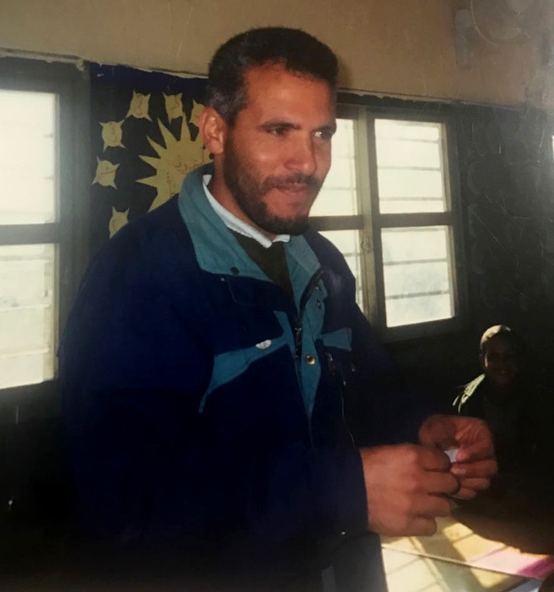 Candid photograph of smiling man