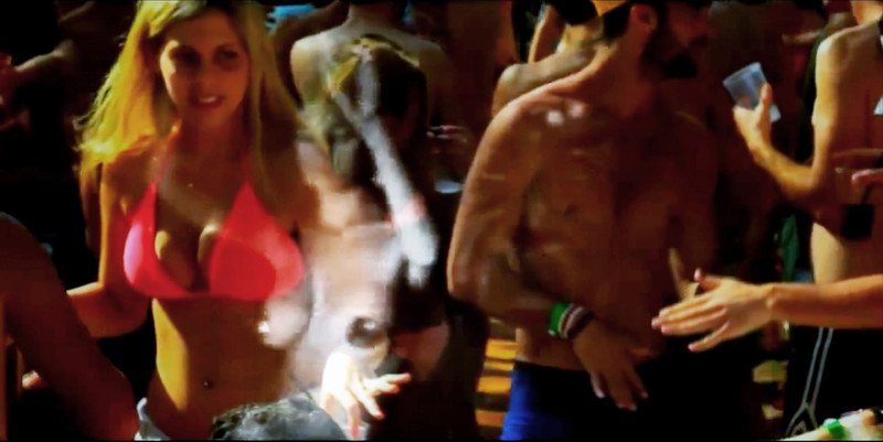 Image of topless belly dancer is superimposed on image of woman in bikini and topless man at Tel Aviv party