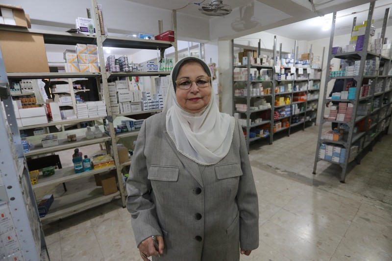 Hayfaa Shurrab stands in pharmacy stock room
