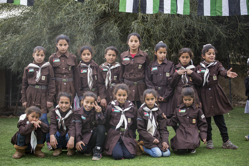 Palestinian schoolchildren in uniform pose for