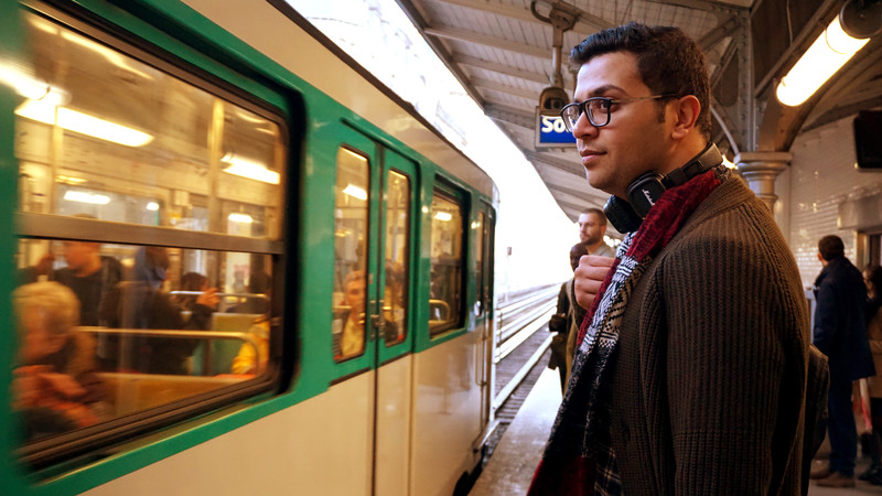Portrait of young man standing at a train platform