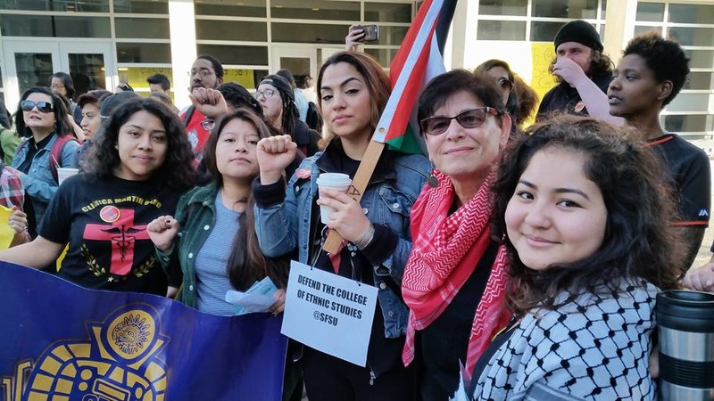 Professor Rabab Abdulhadi stands with student supporters at San Francisco State University.